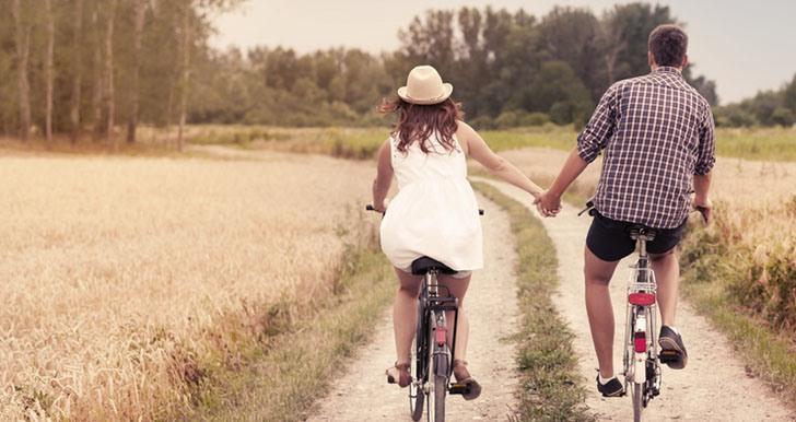 Couple riding bikes outdoors