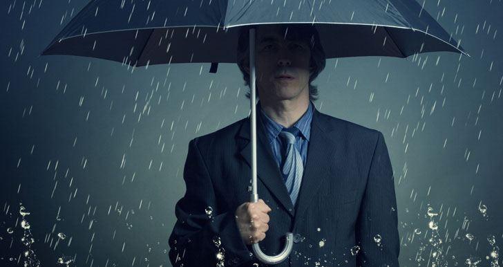 Man alone in the rain